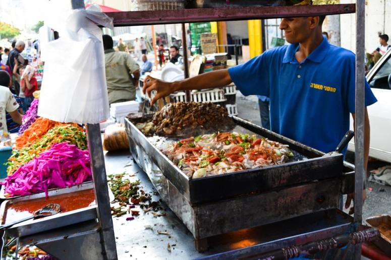 A street vendor prepares shawarma sandwiches at the Friday market in Gaza City.