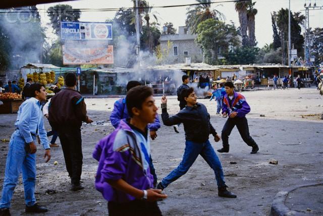 Young Men Throwing Rocks at Riot