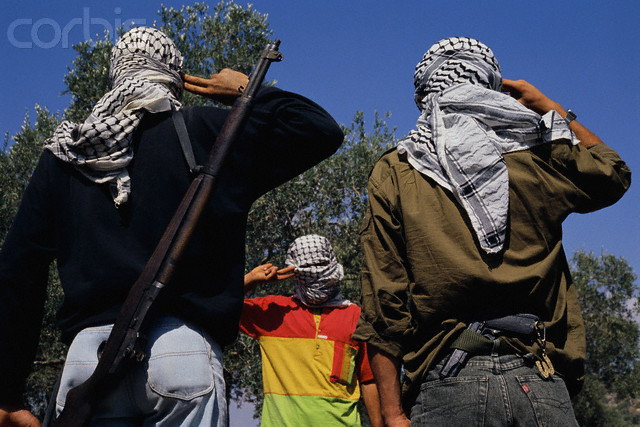 Armed Palestinians Saluting Each Other